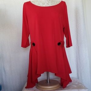Red blouse with black decorative buttons